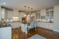 white kitchen cabinets with wood flooring