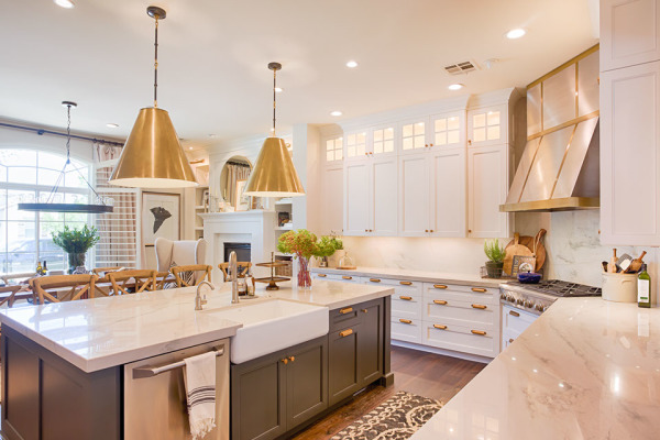 White kitchen cabinets Rose Gold lighting and oven hood, glass uppers